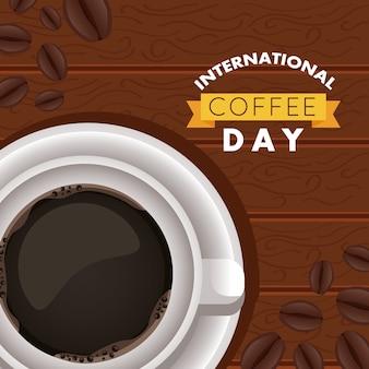 Internationale kaffeetagsfeier mit luftansicht der tasse und der bohnen im hölzernen hintergrund