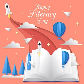 Internationaler alphabetisierungstag mit buch und raketen