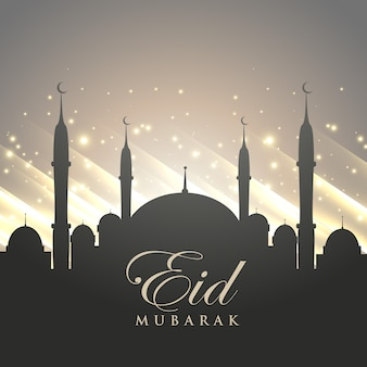 Islamischen eid festival gruß mit moschee silhouette und glänzenden hintergrund