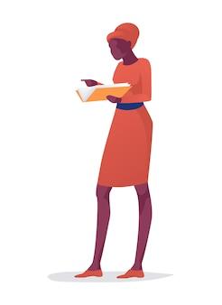 Isolierte afroamerikanische dame, die mit buch steht