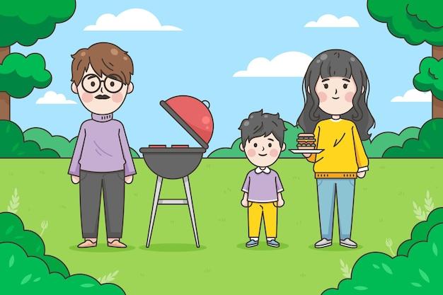 Japanische familie, die einen grill im freien genießt