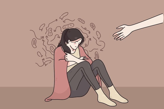 Jemand, der der depressiven weinenden unglücklichen frau hand gibt, die mit negativen gedanken auf dem boden sitzt
