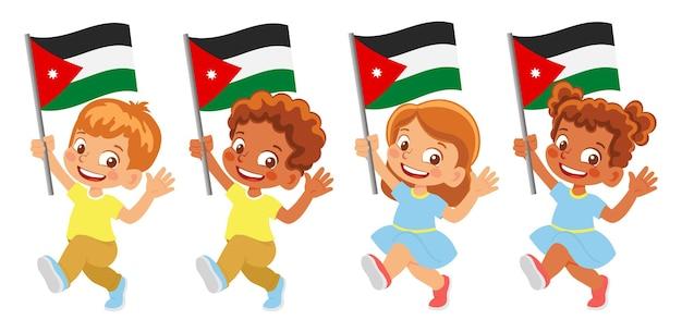 Jordanische flagge in der hand. kinder, die flagge halten. nationalflagge von jordanien
