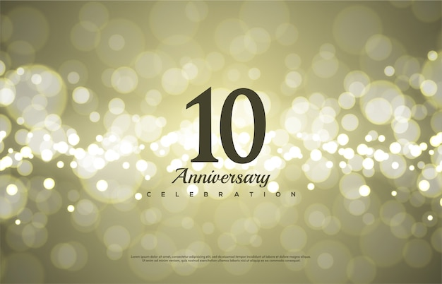 Jubiläumsfeier nummer mit der nummer 10 in schwarz auf einem bokeh hintergrund.