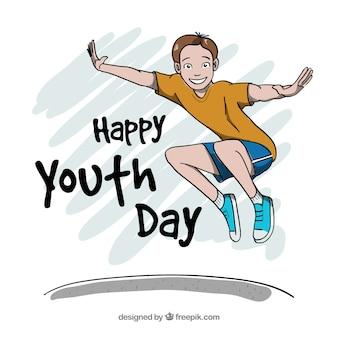 Jugendtaghintergrund mit dem glücklichen Jungenspringen