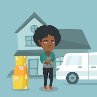 Junge afroamerikanerfrau, die auf ein neues haus umzieht