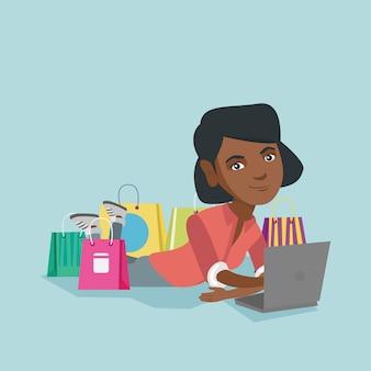 Junge afroamerikanerfrau, die das on-line-einkaufen tut