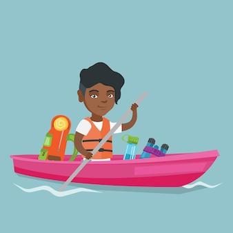 Junge afroamerikanerfrau, die einen kajak reitet.