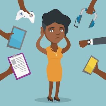 Junge afroamerikanerfrau umgeben durch geräte