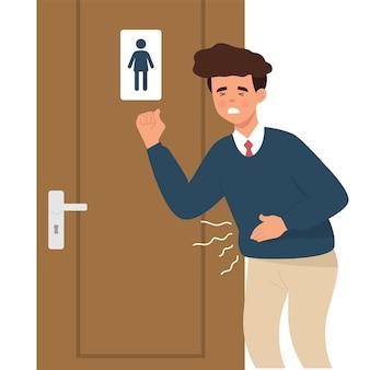 Junge arbeiter halten den magen wegen durchfall oder wollen kot