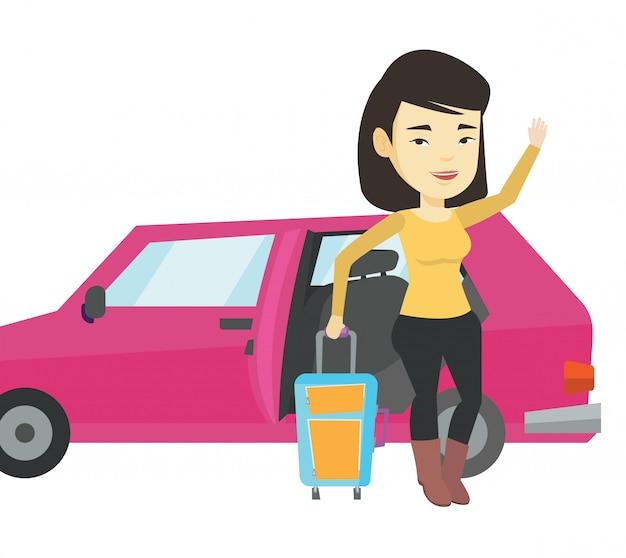Junge asiatische frau, die mit dem auto reist.