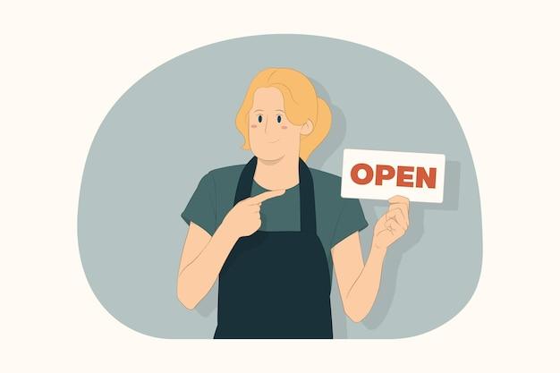Junge barkeeperin, die mit dem zeigefinger auf das schild mit dem open-titelkonzept zeigt