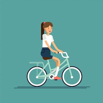 Junge dame, die spaß beim fahrradfahren mit blumenkorb hat. kind hat am wochenende freizeit. sommerpause erholung im freien für junioren.