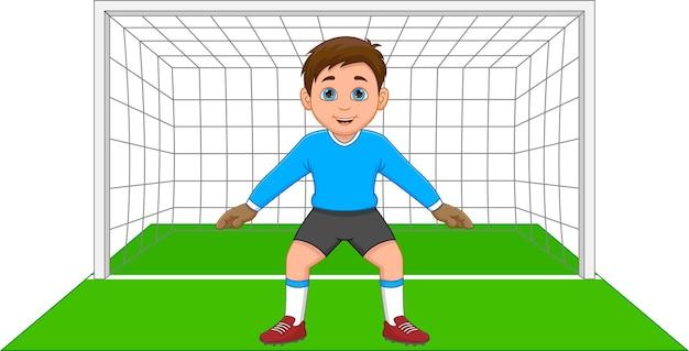 Junge, der als torwart fußball spielt