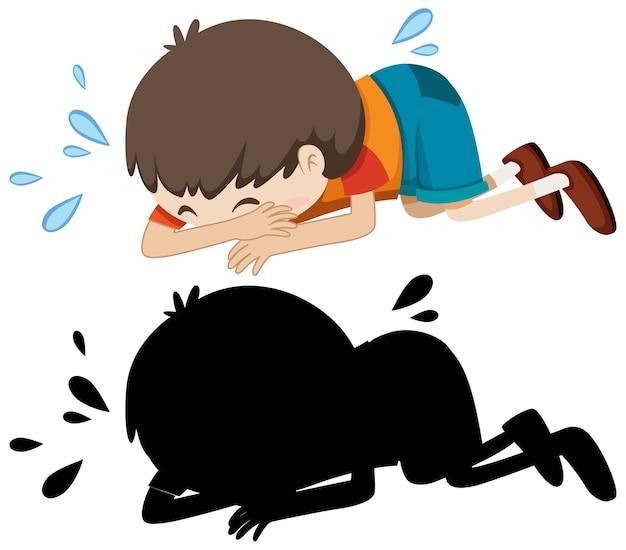 Junge, der auf dem boden mit seiner silhouette weint