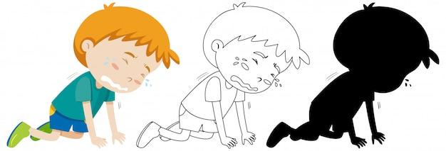 Junge, der auf der bodenposition mit seinem umriss und der silhouette weint