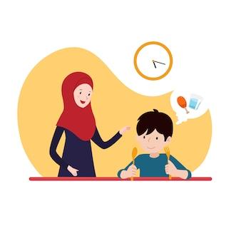 Junge, der auf die pause des iftar wartet, während er mit seiner mutter im hijab fastet. familie ramadan aktivität