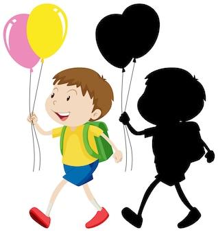 Junge, der ballon mit seiner silhouette hält