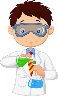 Junge, der chemisches experiment tut