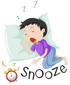 Junge, der mit dem dämmernden wecker schläft