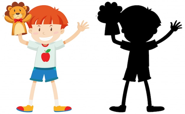 Junge, der mit puppenhand in farbe und schattenbild spielt