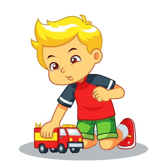 Junge, der mit seinem lkw-spielzeug spielt