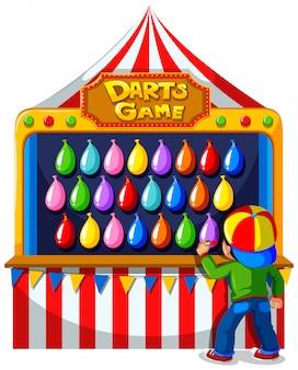 Junge, der pfeilspiel am karneval spielt