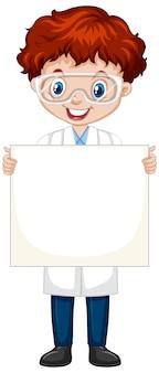Junge, der unbelegtes papier auf weiß anhält