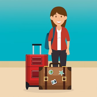 Junge frau am strand mit koffer