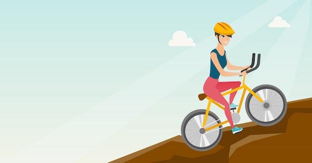 Junge frau auf dem fahrrad, das in die berge reist