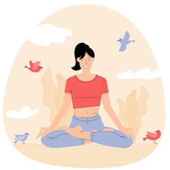 Junge frau beim yoga im lotussitz mit geschlossenen augen sitzend