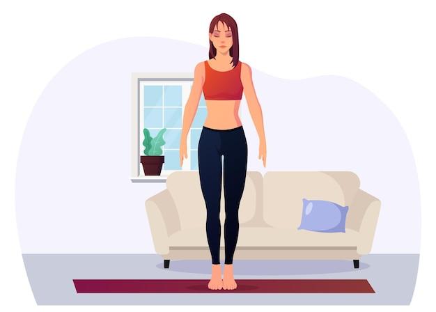 Junge frau beim yoga in bergpose zur entspannung und achtsamkeit
