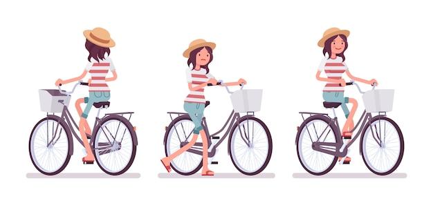 Junge frau, die ein fahrrad radfährt