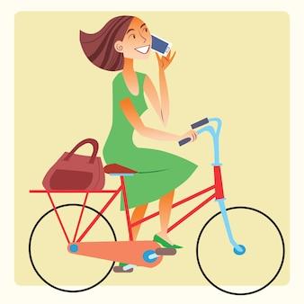 Junge frau, die fahrrad fährt und auf dem smartphone spricht