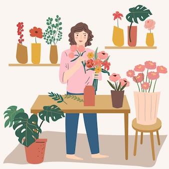 Junge frau, die floraanordnung macht. florist, blumenladenbesitzer.