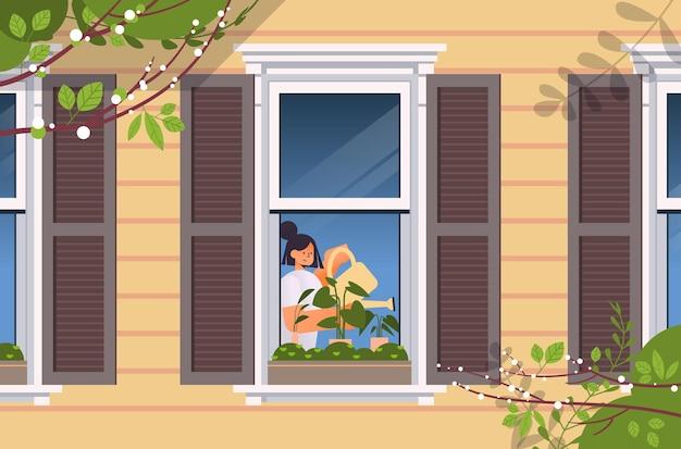 Junge frau, die gießkanne hält und pflanzenhausgarten-konzeptmädchen gießt, das zimmerpflanzen im hausfensterporträt horizontale illustration kümmert