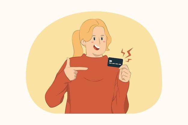 Junge frau, die lässigen pullover zeigt zeigefinger auf kreditkartenkonzept