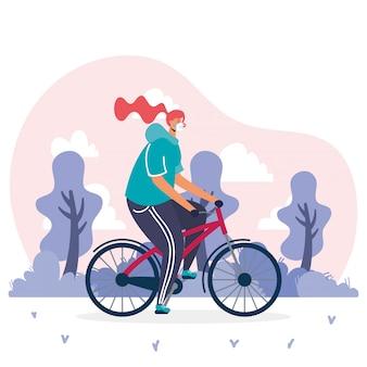 Junge frau, die medizinische maske im fahrrad trägt