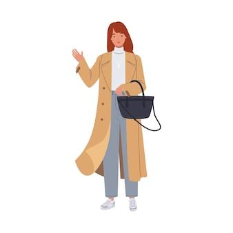 Junge frau, die modischen mantel trägt. weibliche figur in modekleidung mit trendiger handtasche. illustration in einem flachen stil