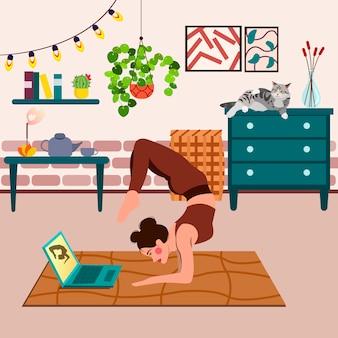 Junge frau, die online-yoga-training in einer modernen trendigen wohnung tut. online-trainingskonzept. live-stream, internet-bildung.