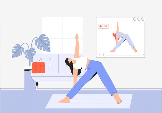 Junge frau, die yoga im gemütlichen raum mit einem modernen innenraum, online-yoga, heimfitness und zu hause bleibt.