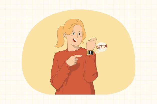 Junge frau, die zeigefinger auf smartwatch auf handkonzept zeigt