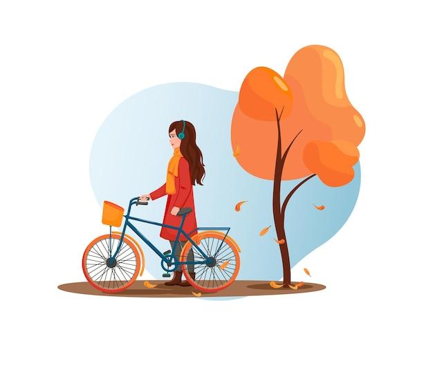 Junge frau geht mit dem fahrrad im park
