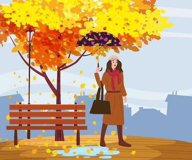 Junge frau in der herbstparkstadt mit regenschirm, trendige kleidung straße modischen stil outwear weiblich