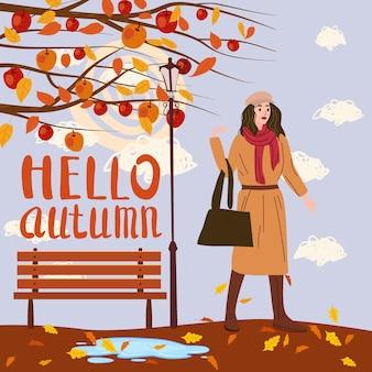 Junge frau in der herbstparkstadt, trendige kleidung straße modischen stil outwear weiblich, herbststimmung. schriftzug hallo herbst