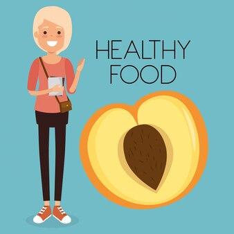 Junge frau mit gesundem lebensmittel des pfirsiches