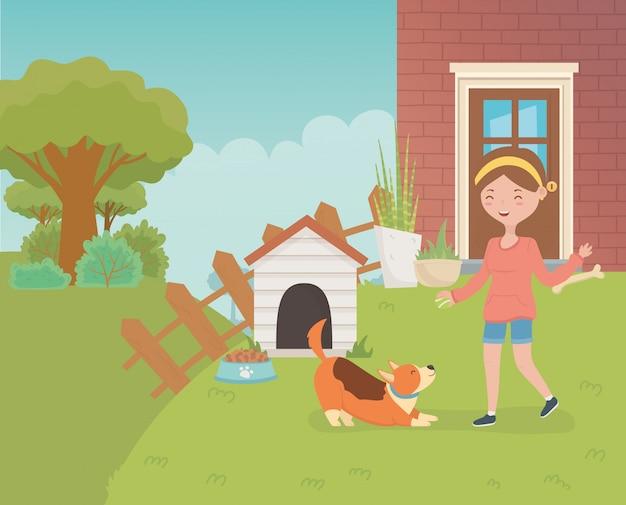 Junge frau mit kleinem hundemaskottchen im hausgarten