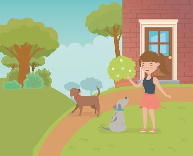Junge frau mit kleinen hundemaskottchen im hausgarten
