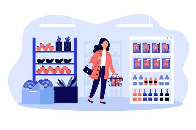 Junge frau mit korb, der lebensmittel in der flachen illustration des supermarkts kauft