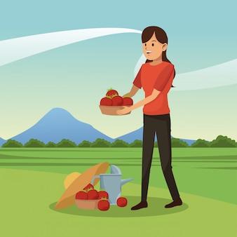 Junge frau mit tomatenernte